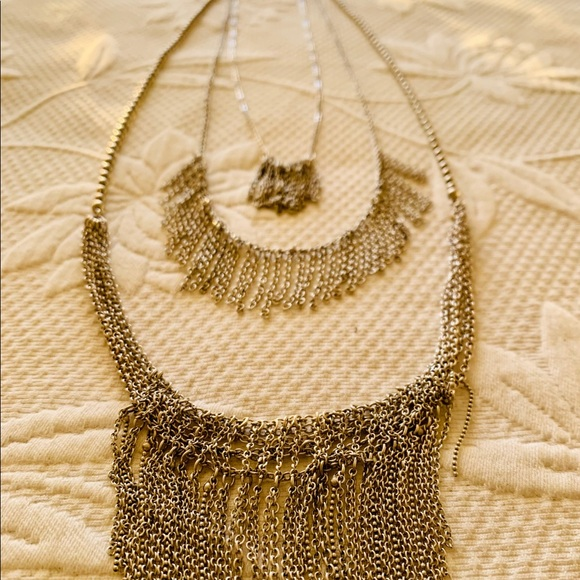 Layered silver chain necklace. Wears long.
